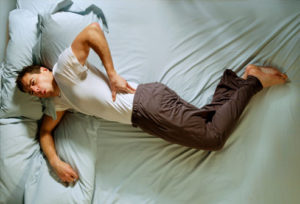 picture_of_man_with_back_pain_made_worse_by_rest_in_bed_walking_tall_chiropractor_Goa_india-300x204.jpg