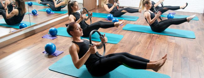 Sporty-young-women-with-exercising-rings-in-fitness-studio.-916474944_5664x3776-650x250.jpeg