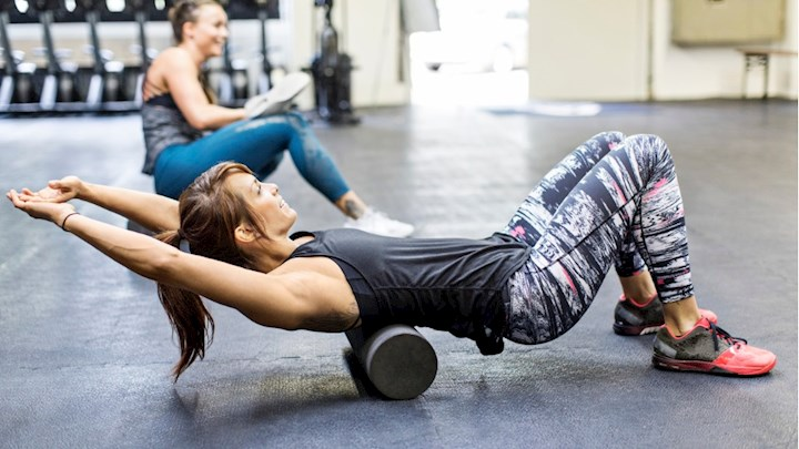 women-exercising-on-foam-rollers-in-gym-picture-id686409516.jpg
